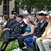 LTG Lynch, Mrs. Sarah Lynch and CSM Ciotola listen as Daniel Medrano, president of the Vietnam Veterans of America Chapter 366, welcomes servicemembers, veterans and Fiesta royalty to the San Antonio Fiesta's All-Veterans Memorial Service