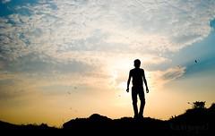 I walk alone (puzzlescript) Tags: sun man nikon walk vizag d3000 silloutee