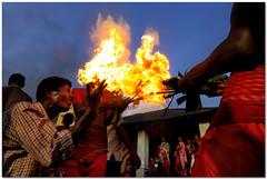 fireplay - 2 (Soumya Bandyopadhyay) Tags: red people festival fire low wide perspective ritual splash throw westbengal gajon canoneos50d charak tokina1116mm