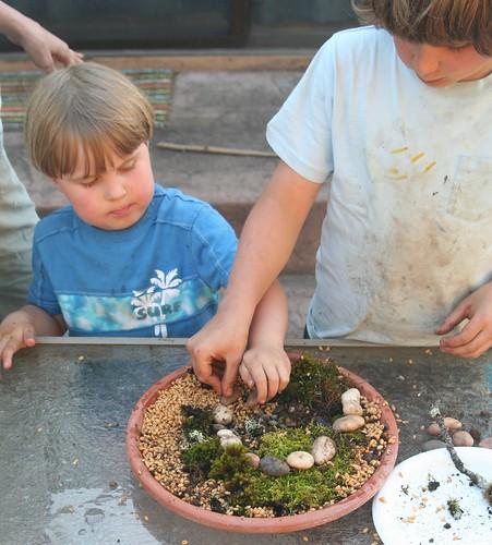 Dish Garden in Progress: Lucas Making a Stone Spiral