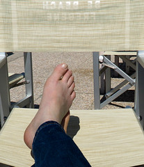 kick back (lam 09) Tags: sun feet beach metal naughty relax foot chair toes nail canvas jeans barefoot bolt trousers denim sole bigfoot sedia spiaggia piede piedi toenail fregene kickback unshod bebeach foldingarmchair fetishforsome objectinphotois aslargeasitappears