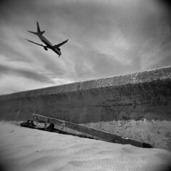 Wall #3 (LowerDarnley) Tags: beach wall airplane holga airport winthrop massachusetts jet 120n
