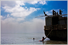 Band of Brothers III (Sopnochora) Tags: sky boys river boat jump play bluesky bangladesh cloudpattern maowa sopnochora vagyakul gameofyouth mdhuzzatulmurasalin