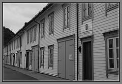 Alesund harbour (Audrey A Jackson) Tags: road blackandwhite building sign norway doors harbour footpath alesund windos canon450