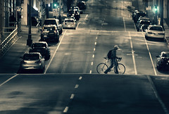 walking biker (sparth) Tags: road seattle cars silhouette night contrast walking evening washington downtown nightshot 300mm vehicles telephoto april biker 300 cycliste downtownseattle contrasted 2011 300mm28l 5dmkii