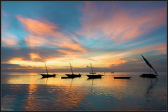 Zanzibar Sunsets (Joost N.) Tags: ocean life africa travel pink blue light sunset sea sky orange holiday fish tourism beach water colors yellow tanzania boats island licht boat fishing fisherman zonsondergang nikon village african hard sails catch afrika zanzibar nikkor joost unguja d700 notten
