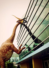 Peepasaurus (SOMETHiNG MONUMENTAL) Tags: reflection glass canon giant dinosaur indianapolis indiana roadsideamerica welcomecenter g11 childrensmuseumofindianapolis somethingmonumental mandycrandell