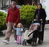 Nora on a walk with Grandma and Grandpa (crop)