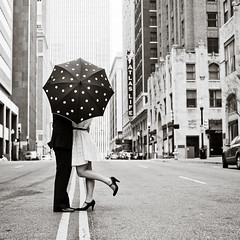umbrella kiss (crystal.franks) Tags: bw white black love umbrella vintage foot engagement kiss couple downtown pop bsquare