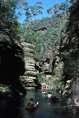 Canyon liloing, 1979 (NettyA) Tags: park film creek 35mm sandstone floating australia slide bluemountains canyon cliffs national bushwalking nsw scanned newsouthwales kodachrome wilderness lilo canyoning airbed wollemi bushwalkers wollangambe liloing janettetomsett