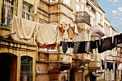 Laundry (E.L.A) Tags: old city sky house window horizontal architecture facade turkey outdoors photography clothing europe day apartment balcony citylife nobody nopeople istanbul clean laundry hanging clothesline washing hygiene variation gettyimages between drying routine inarow deterioration brightlylit casualclothing urbanscene groupofobjects colorimage tarlabasi buildingexterior builtstructure