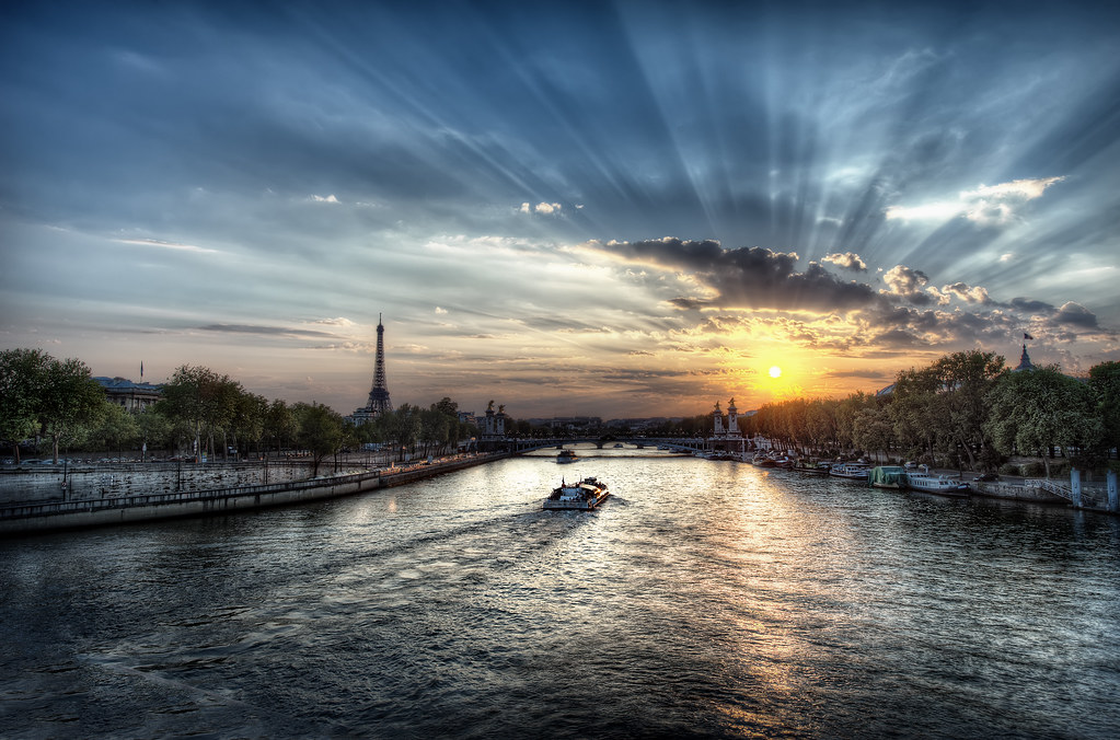 The sun setting behind the Eiffel Tower in Paris, France.