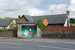 Ynyswen Bus Stop (Steve Ellaway) Tags: street trees houses urban orange detail bus lines tarmac wall wales composition contrast fence painting evening bottle community election mural village dusk squares pavement framed empty stonework transport banner archive shapes documentary ivy boring roofs sidewalk busshelter tiles views frame council vernacular series local form walls welsh geography streetfurniture slate roads gables juxtaposition bungalow eves timetable banal childish compare rectangles roadmarkings liberaldemocrats liberaldemocrat busstops layby councilor politicalsign localelections topographics orangedrink welshvalleys fforestfawr tawevalley photographicsurvey a4067