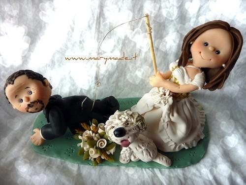 Il cake topper della sposa che ha pescato lo sposo!