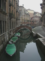 Boats on a canal in Venice, Italy by Danalynn C