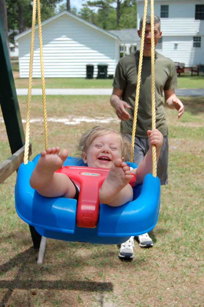 swinging makes her happy!
