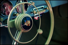 Inside the 356 (Eric Flexyourhead) Tags: canada detail classic car vintage bc bokeh britishcolumbia interior german porsche northvancouver instruments steeringwheel gauges fragment waterfrontpark porsche356 356 2011 zd 50mmmacro20 50mmmacrof20 germancarfestival olympuse3
