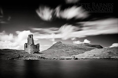 Ardvreck Castle on Loch Assynt in Scotland - Explored (Pete Barnes Photography) Tags: sky blackandwhite cloud mountain lake castle water mono scotland loch ardvreck assynt