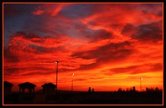 Inferno in the heavens.!!!!! (Mumsie Wood) Tags: trees houses sunset sky orange rooftop yellow haze view bright blues angry lamps colourful tones bushes lanscape fiery ablaze campover