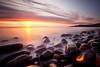 4 a.m. (Chee Seong) Tags: uk longexposure morning light england sky cloud sun seascape beach water rock sunrise canon smooth alnwick northumberland coastline serene tranquil craster canon1740mm 5dm2