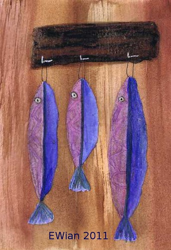 three little fishes hanging in a row 12