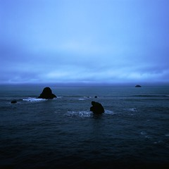 To Be As Free As You (nathanielperales) Tags: ocean man clouds oregon coast rocks hasselblad highway101 carlzeiss portlandtrip hasselblad500cm ilovefilm beachcoast 0161 carlzeissdistagon50mmf4 fujichromevelvia100frvp iwanttobeasfreeasyou theressomuchmisunderstanding iwanttobelostforever outforever