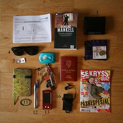 What's in my bag? (Travel style) (mazarin) Tags: money sunglasses notebook keys phone wallet crossword books pens passport bandaid traveldocuments mpplayer