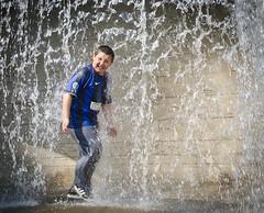 Larking Lad (pickup2sticks 6.6 million views) Tags: street light boy people water waterfall cool nikon energy action candid tamron dcpc d7000 gjkerr