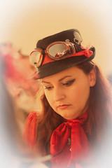 Pensando... (krisina) Tags: portrait hat retrato goggles santiagodecompostela sombrero steampunk thoughful pensativa retrofuturista 2011 canonef85mmf18usm ucronía canoneos500d uchronie 7demayode2011 l´extraordinaireuchronie casadelasasociaciones
