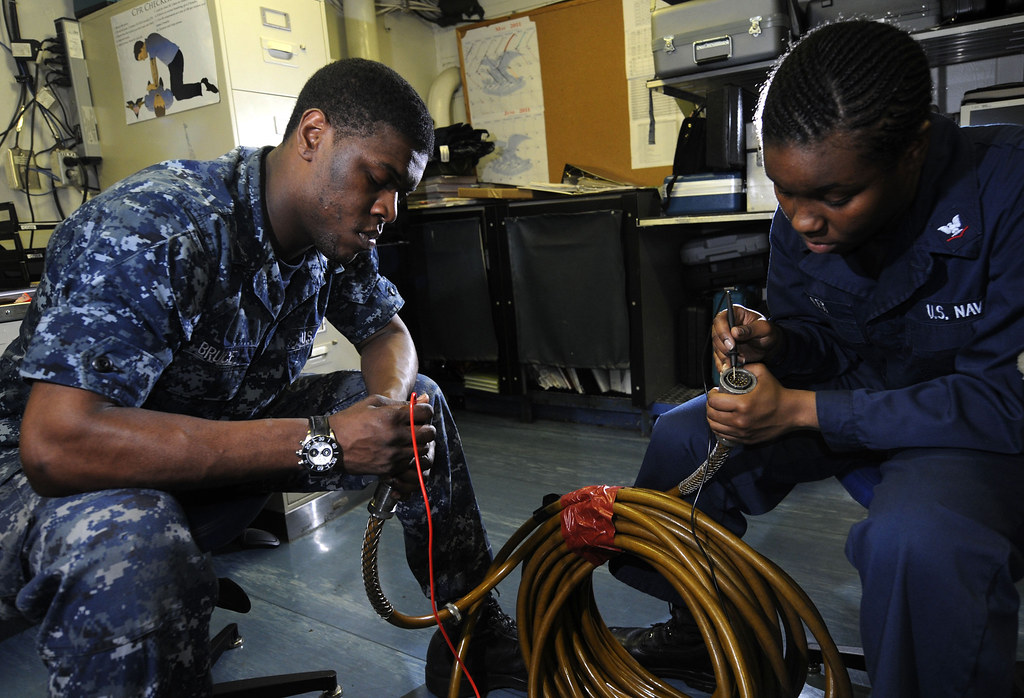 Sailors check an alignment on an inertial alignment system umbilical cable aboard USS Carl Vinson