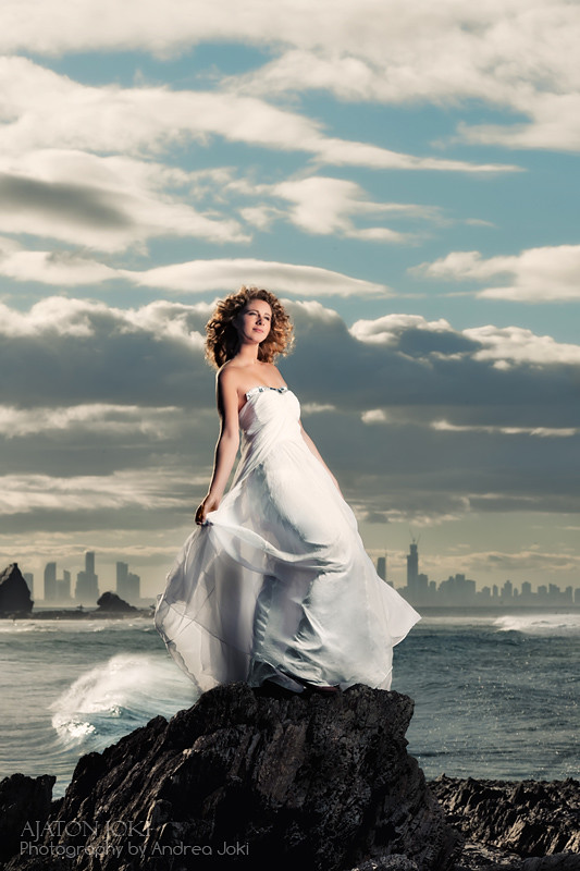 magda and flowing dress on the rocks at currumbin