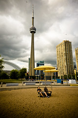can't escape the skyline, dude (zakonslike) Tags: toronto beach skyline sand harbourfront rogerscentre muskokachair yellowumbrella