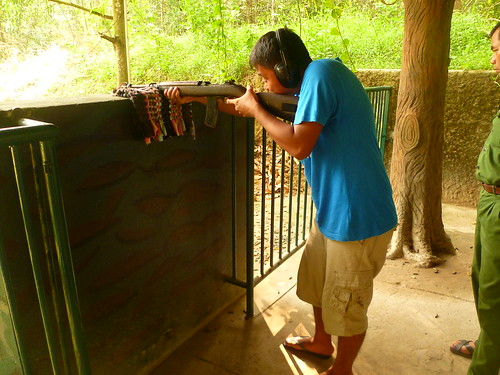 Shooting a rifle in Cu Chi Tunnels in Vietnam