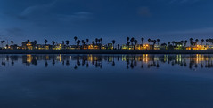 Venice In Reverse (Wilkof Photography) Tags: venice venicebeach bluehour palmtree losangeles california veniceboardwalk houses homes architecture rowhouse beach beachfront buildings boardwalk canont4i cloudy canon countryside dusk evening landscape light 18135mm 18mm lens longexposure le nature night city cityscape oceanfront ocean perspective panoramic panorama reflection shadow skyline sky sand symmetry silhouette trees water wet wilkofphotography