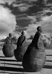 the three (Toria_Steel) Tags: blackandwhite sculpture monochrome mono nikon southshields littlehaven wobbly weebles juanmunoz d5000