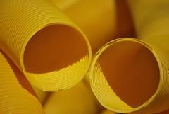 Communicating Tubes (Scilla sinensis) Tags: yellow tubes gelb gul drainage schläuche schlauch rohre buildingmaterial baustoff baustoffe