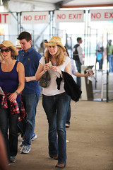 Cowgirls at the Gates (wyojones) Tags: boy woman man money cute guy girl beautiful hat sunglasses gate pretty texas dress boots entrance houston shades jeans jacket blonde rodeo bluejeans cowboyhat tennisshoes houstonlivestockshowandrodeo livestockshowandrodeo browneye cowgirlhat wyojones rodeodress