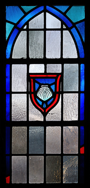 Saint Nicholas Roman Catholic Church, in Pocahontas, Illinois, USA - stained glass window of baptismal shell