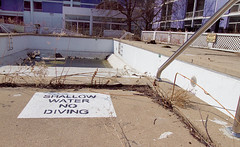 shallow dive (Jonathon Much) Tags: trees shadow urban plant tree texture water rotting pool grass leaves metal america canon painting landscape hotel mirror illinois weeds stencil bars paint shadows purple angle decay metallic no steel empty painted tripod north dive lavender angles wideangle landmark il textures age american gross 7d abandonded northside aged shallow waste rotten stripped aging springtime lincolnwood drained chicagosuburbs 2011 purplehotel canon7d