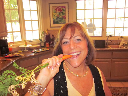 Lainey w/ a carrot from her garden
