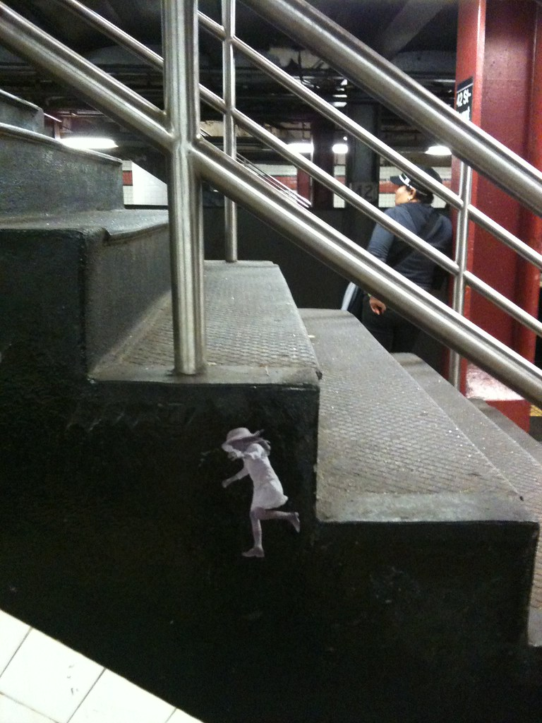 Girl Leaping Off Times Square Steps