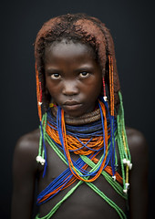 Mwila Girl With The Traditional Vikeka Necklace, Angola (Eric Lafforgue) Tags: africa people tourism girl childhood vertical dreadlocks female youth standing person one beads kid child tribal ornament innocence braids tribe humanbeing plaits oneperson huila colorphoto angola tourismo southernafrica mwela lookingatcamera waistup ethnicgroup traditionalhairstyle  mumuila   mumuhuila mwila      southangola mumuhuilatribe mwilatribe nontombi mudnecklace ango3923