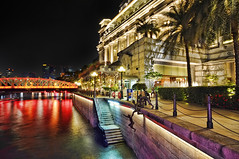 The Singapore River comes alive when night falls... (williamcho) Tags: sculpture history tourism colors hotel colorful riverside bridges entertainment historical service nightlife magical nationalmonument attraction andersonbridge singaporeriver riverbanks rivermouth cavenaghbridge fullertonhotel d300 rivertaxi foodbeverage flickraward ilovemypics topazlabadjust williamcho
