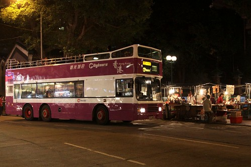 Open top bus delivers tourists to the Temple Street night market, Hong Kong