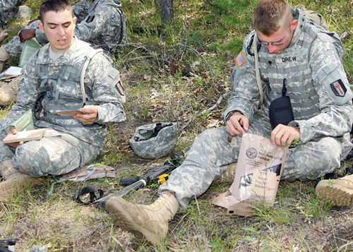 090814-3834S-5553. Members of the 338th Engineer Company test Meals, Ready-to-Eat at a Fort McCoy training site on South Post as part of a Natick Soldier Research project at Fort McCoy Aug. 14. Photo by Rob Schuette, PAO, Fort McCoy, WI. Publication or commercial use of this material requires release by a U.S. Army Public Affairs Officer. Credit U.S. Army photograph.