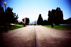 VIP (lomoD.xx) Tags: park blue sky sculpture mountain lake france annecy art water grass clouds landscape lomo lca xpro crossprocessed xprocess slide lomolca lampost vip 100 agfa agfaprecisa vignette deserted agfaprecisa100 lomodxx precisa omo lakeannecy precisa100 lomodxxwall