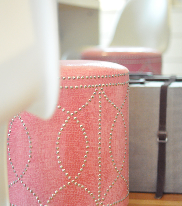 pink ottoman + vintage suitcase +panton chair