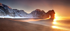 December Sunrise Durdle Door (peterspencer49) Tags: ocean greatbritain light sea england snow seascape southwest clouds sunrise coast europe unitedkingdom pebbles worldheritagesite dorset stunning limestone coastline oceanview seaview coastalpath westcountry seaarch southwestcoast durdledoor stonearch jurassiccoast dorsetcoast southwestcoastalpath juassic stunningview seascene 5dmkll peterspencer stunningseascape