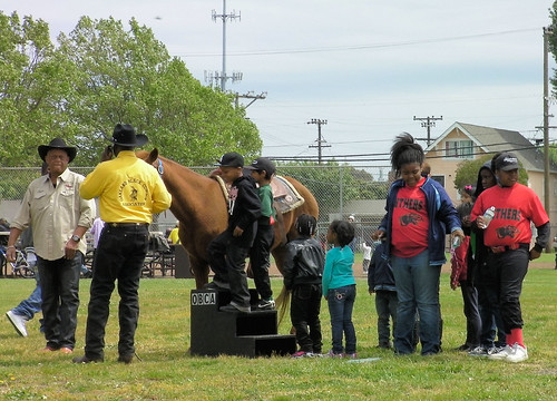 Children take turns sitting on a horse from the Oakland Black Cowboys Association on Saturday at the North Richmond Green parade and celebration.