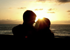 Lovers (Pea Nuht) Tags: sunset shadow woman sun man love beach boyfriend water silhouette clouds eyes girlfriend couple waves silhouettes lovers stare inlove lajollacove